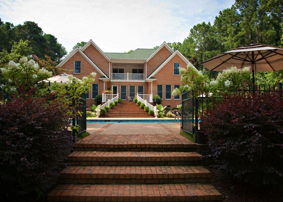 A brick mansion near Mistletoe State Park, Georgia is made for a luxe vacation during the holidays.