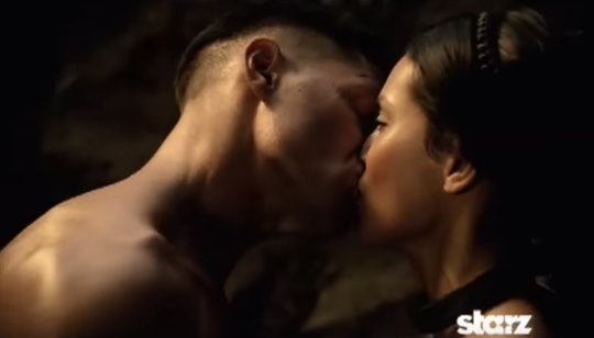 A Spartan soldier kissing a woman.