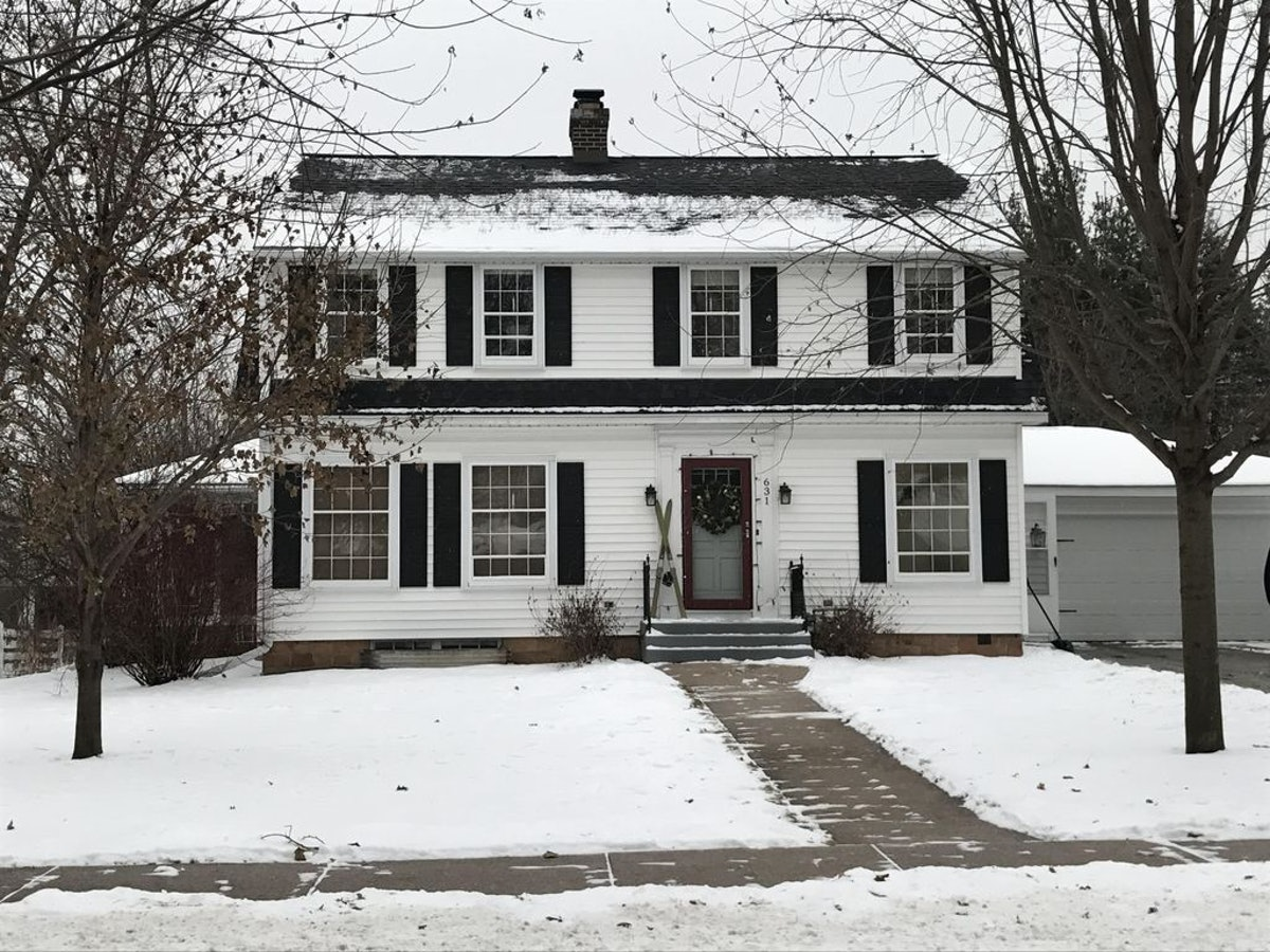 A white house surrounded by snow in Rudolph, Wisconsin is the perfect place to rent for a holiday-th...
