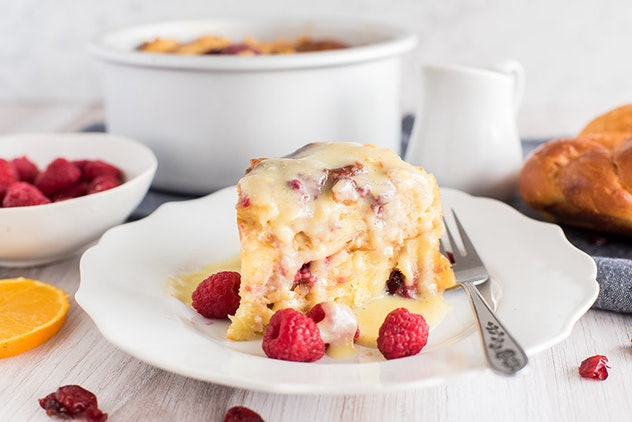 slice of raspberry orange bread pudding on plate