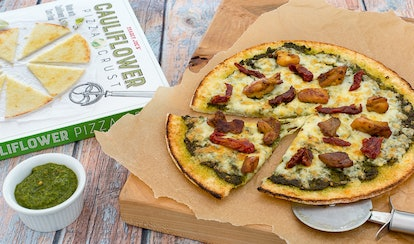 Put your favorite Trader Joe's frozen meals atop a pizza for a simple, elevated meal.