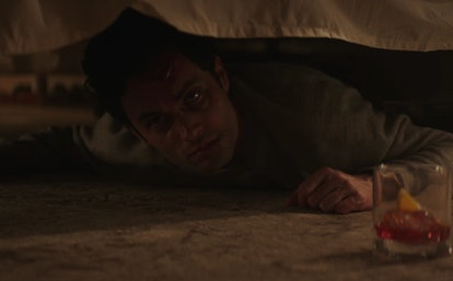 Joe (Penn Badgley) hides underneath the bed in 'YOU' Season 1