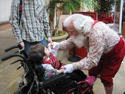 Santas interact with children with autism and special needs at Santa Cares events