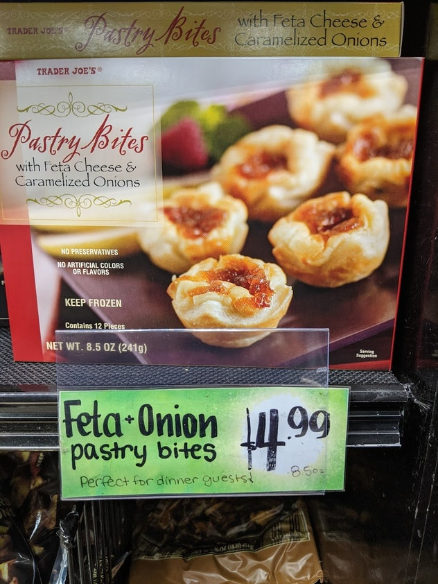 Trader Joe's display of packed, pre-made, frozen Pastry Bites with Feta Cheese and Caramelized Onion...