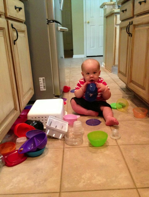 Letting your toddler play in your Tupperware cabinet is one way to keep your toddler busy while cooking