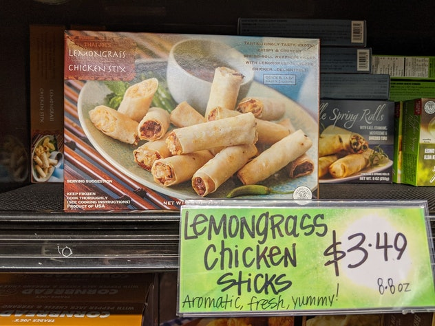 Trader Joe's display of packed, pre-made, frozen Lemongrass Chicken Sticks