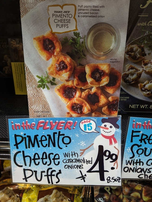 Trader Joe's display of packed, pre-made, frozen Pimento Cheese Puffs
