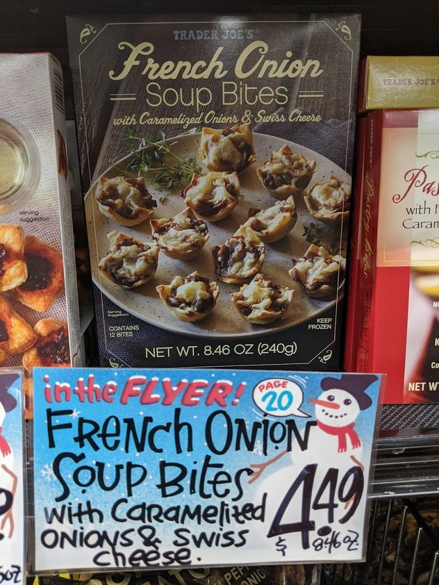 Trader Joe's display of packed, pre-made, frozen French Onion Soup Bites with caramelized onions & s...