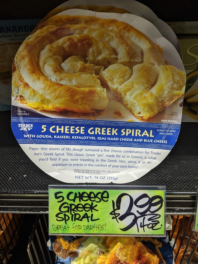 Trader Joe's display of packed, pre-made, frozen 5 Cheese Greek Spiral