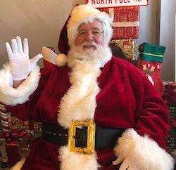 Santa Claus waves hello