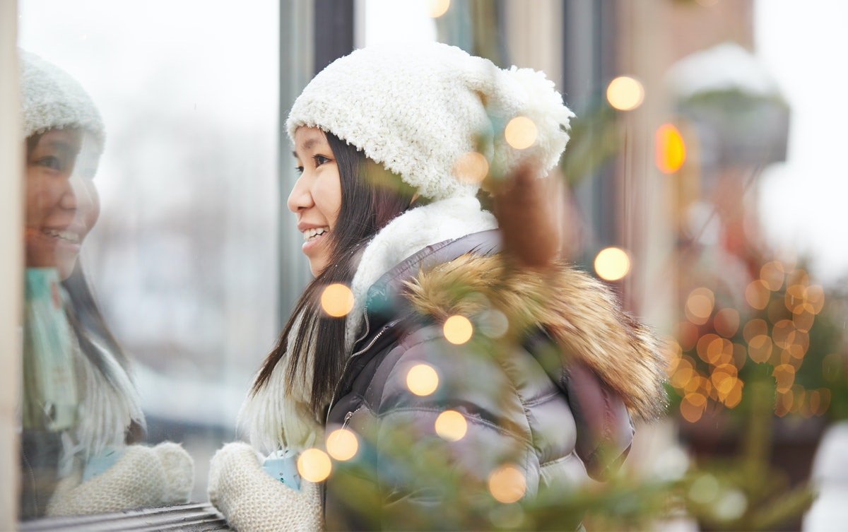 Young Asian woman having best Capricorn season, winter 2019.