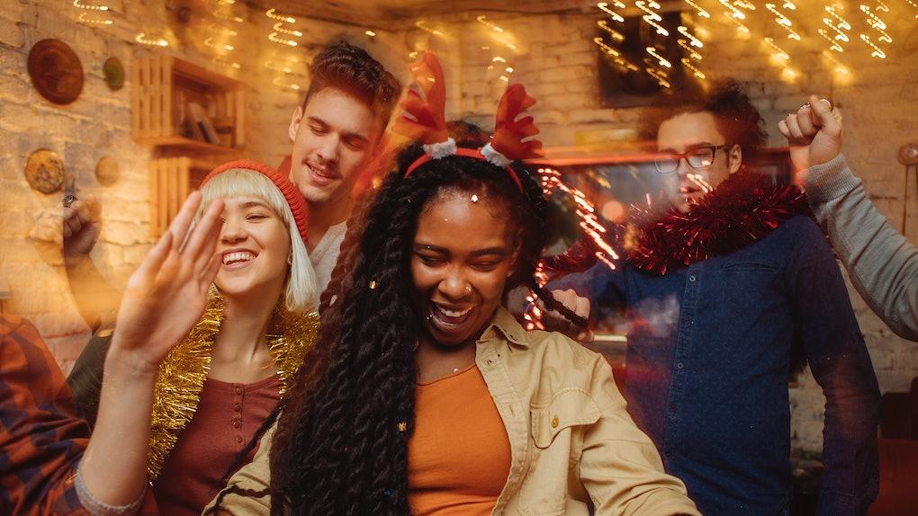 Friends wearing reindeer antlers ahead of Christmas 2019.