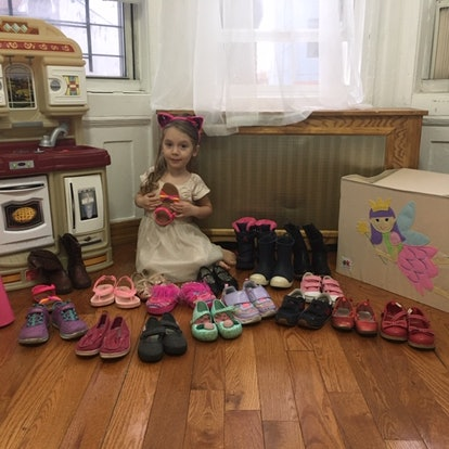 Child with many pairs of shoes