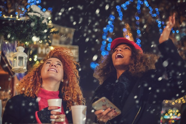 Two girl friends in winter snow.