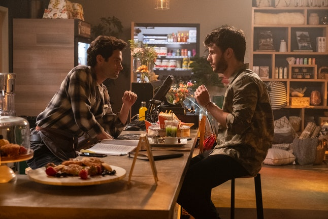 Joe and Forty Quinn bonding over their script in YOU.