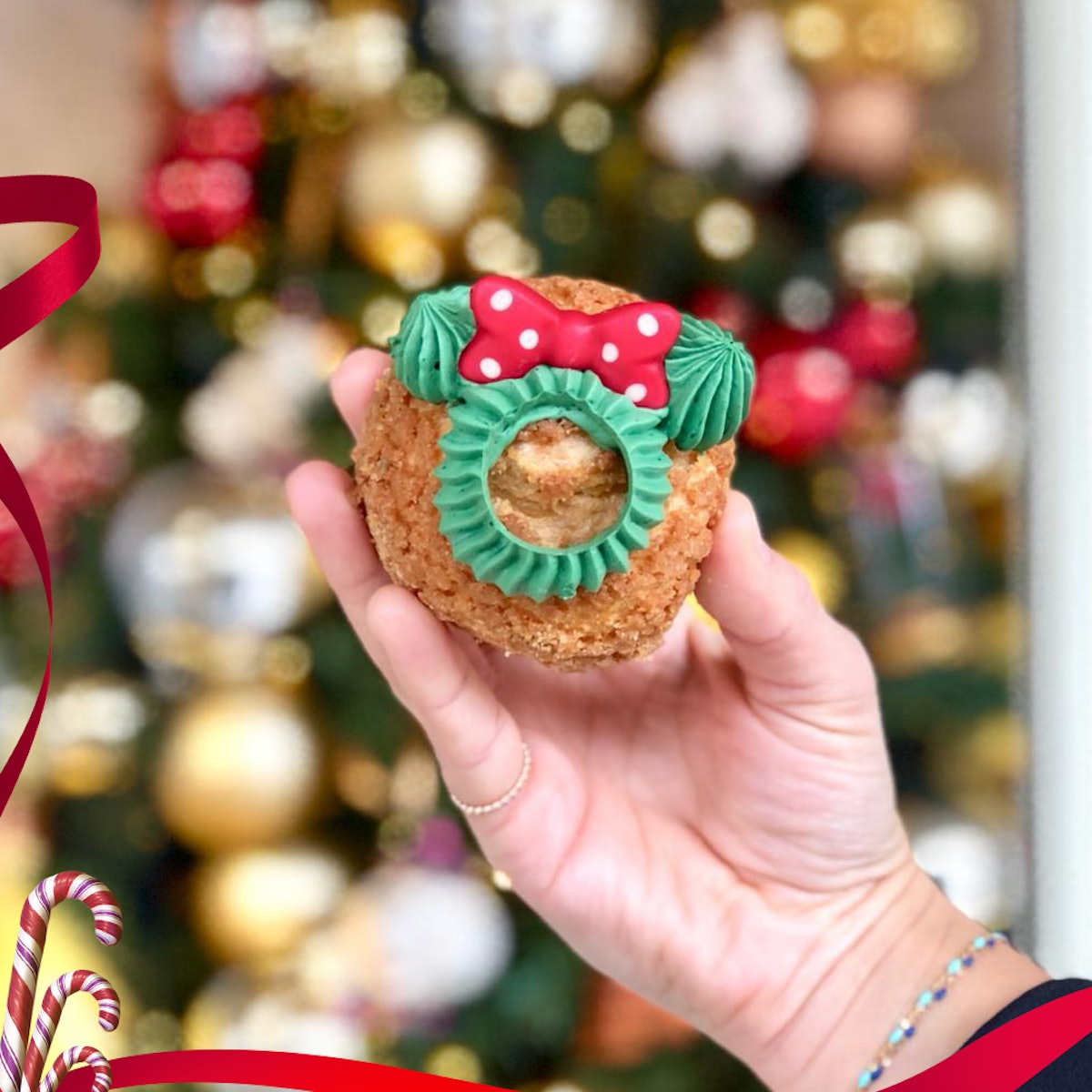 A woman holds up a Minnie's Puf Surprise holiday treat that's available at Disneyland Paris for the ...