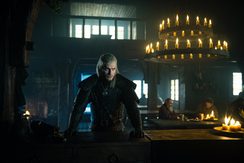 Geralt of Rivia in The Witcher enters a new town and inquires about a monster.