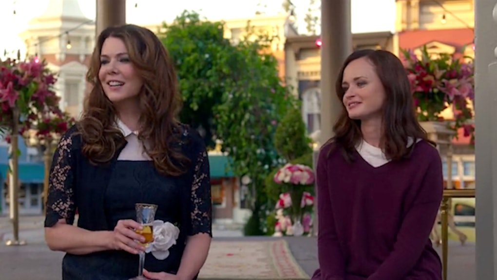 Rory and Lorelai Gilmore from 'Gilmore Girls' smile and sit on the steps of the gazebo in Stars Hollow.