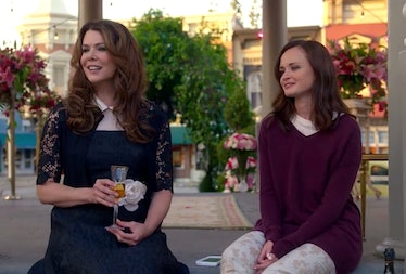 Rory and Lorelai Gilmore from 'Gilmore Girls' smile and sit on the steps of the gazebo in Stars Holl...