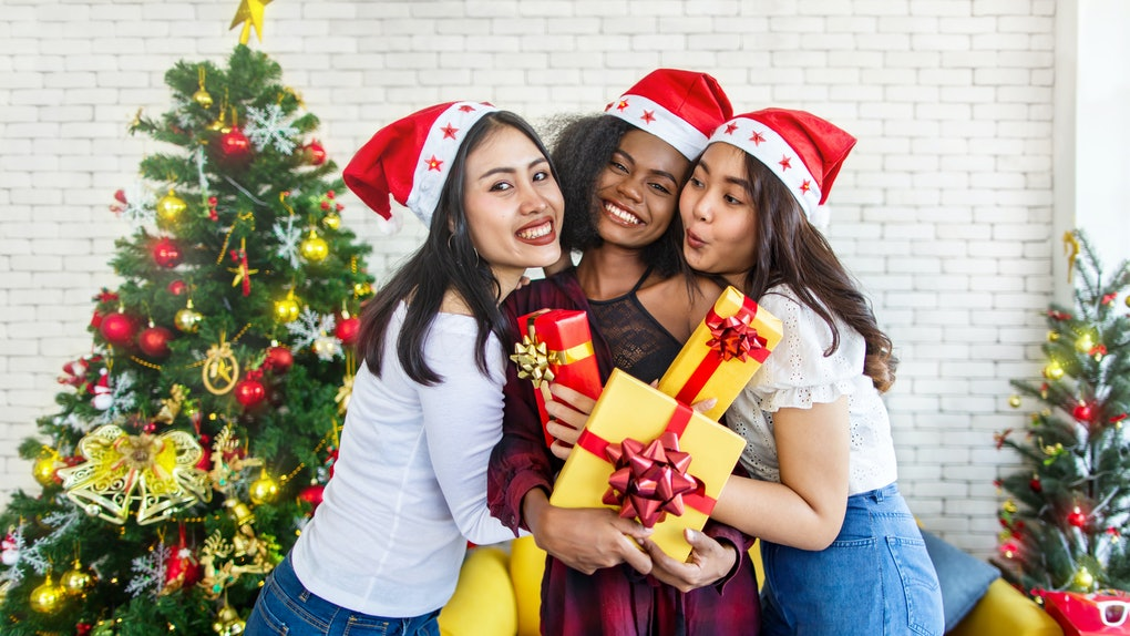 Three girl friends with Christmas presents