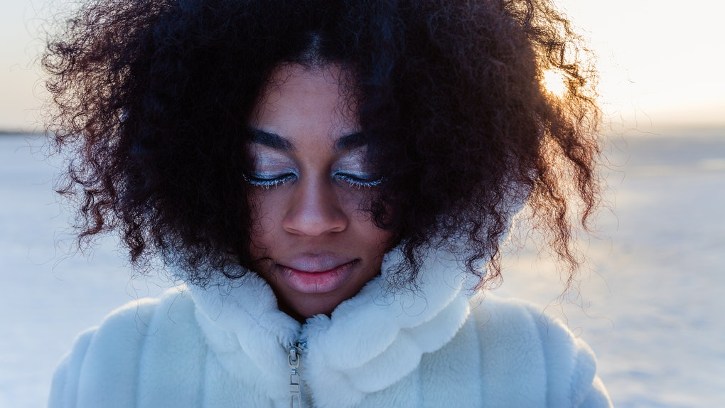 Young black woman in winter solar eclipse 2019