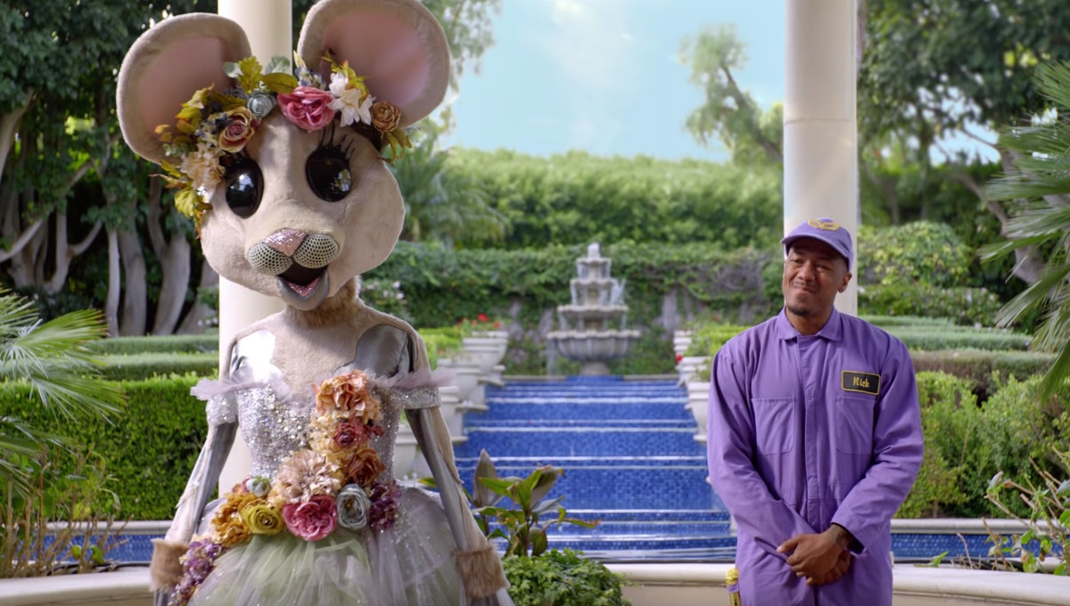 Nick Cannon and a contestant on 'The Masked Singer'