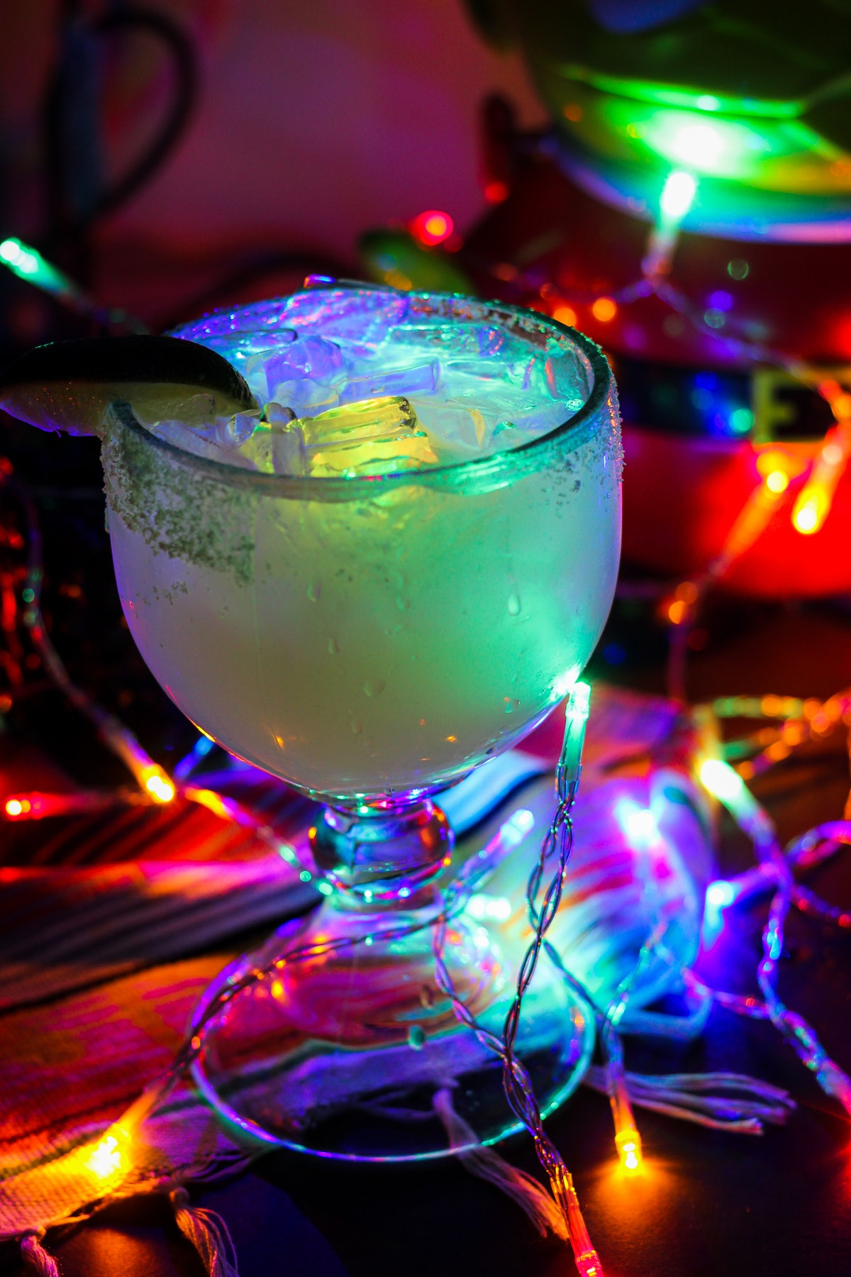 """The glow margarita surrounded by Christmas lights is part of the """"Let It Glow""""-inspired cocktails av..."""