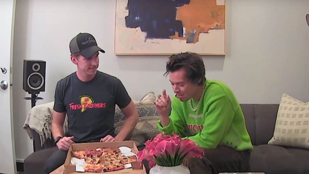 A screenshot from the video of Harry Styles pranking a pizza delivery guy.