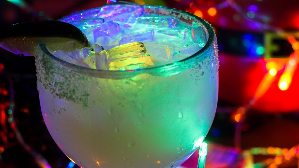 """The Glow Margarita surrounded by Christmas lights is available at Disney for the """"Let It Glow"""" festivities."""