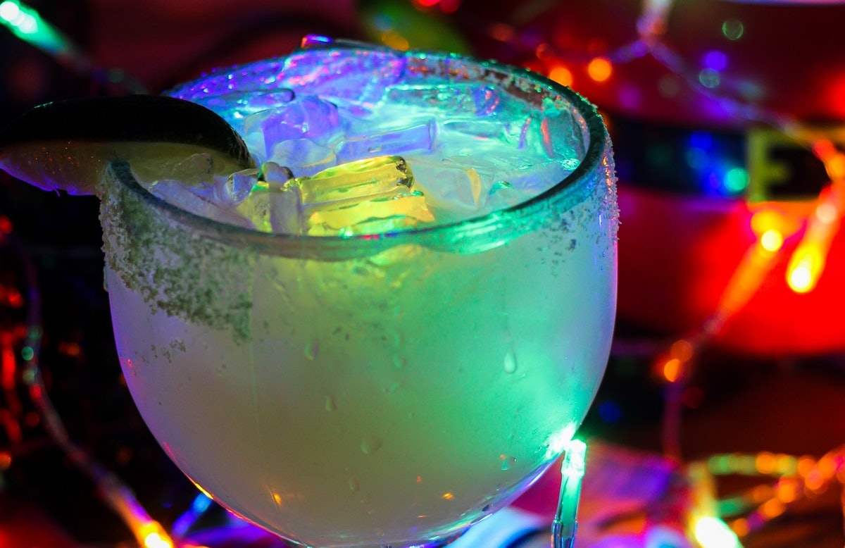 """The Glow Margarita surrounded by Christmas lights is available at Disney for the """"Let It Glow"""" festi..."""