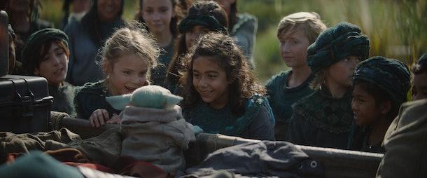 Baby Yoda and children in The Mandalorian