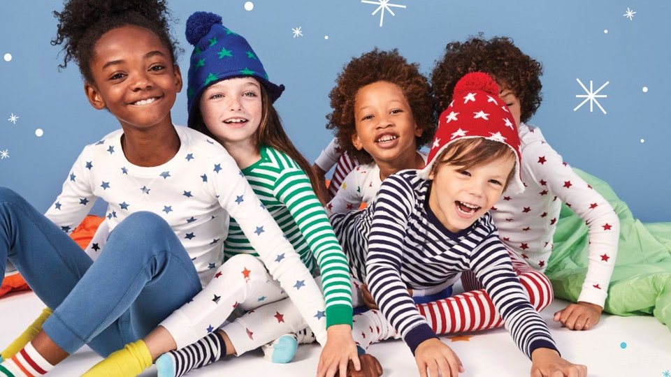Primary promotional photo featuring five kids wearing an assortment of primary socks, pants, tops, and hats