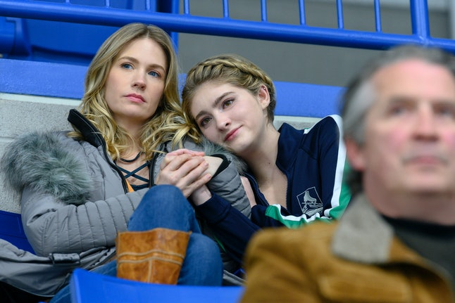 Carol (January Jones) and Serena (Willow Shields) watch Kat take the ice in Netflix's 'Spinning Out'