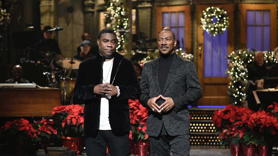 "SATURDAY NIGHT LIVE -- ""Eddie Murphy"" Episode 1777 -- Pictured: (l-r) Tracy Morgan and host Eddie Murphy during the Monologue on Saturday, December 21, 2019 -- (Photo by: Will Heath/NBC)"