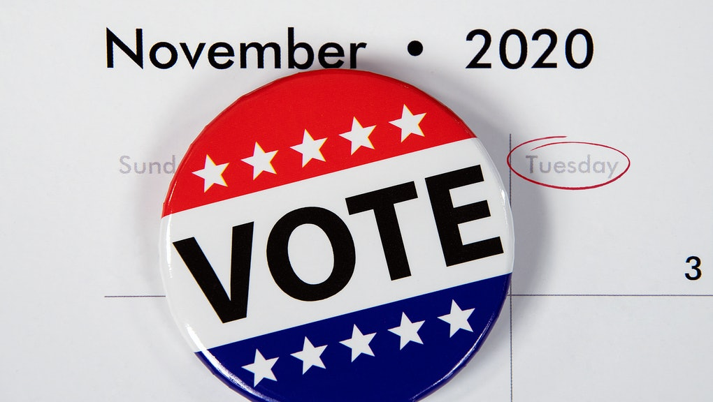 close up of patriotic campaign button on November 2020 calendar