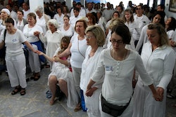 """People pray together to prepare for a healing session at the """"Casa de Dom Inacio de Loyola"""" in Abadiania, in the state of Goias, Brazil.The """"Casa de Dom Inacio de Loyola,"""" or """"The House of Saint Inacio de Loyola,"""" was founded by popular faith healer Joao Teixeira de Faria in Abadiania, Brazil in 1978, where people seek cures for illnesses"""