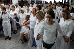 "People pray together to prepare for a healing session at the ""Casa de Dom Inacio de Loyola"" in Abadi..."