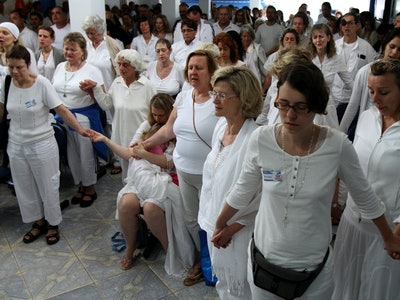 "People pray together to prepare for a healing session at the ""Casa de Dom Inacio de Loyola"" in Abadiania, in the state of Goias, Brazil.The ""Casa de Dom Inacio de Loyola,"" or ""The House of Saint Inacio de Loyola,"" was founded by popular faith healer Joao Teixeira de Faria in Abadiania, Brazil in 1978, where people seek cures for illnesses"