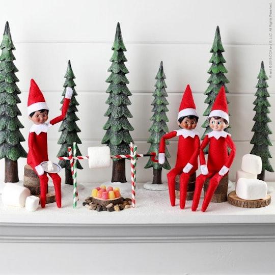 Elves sit roasting marshmallows