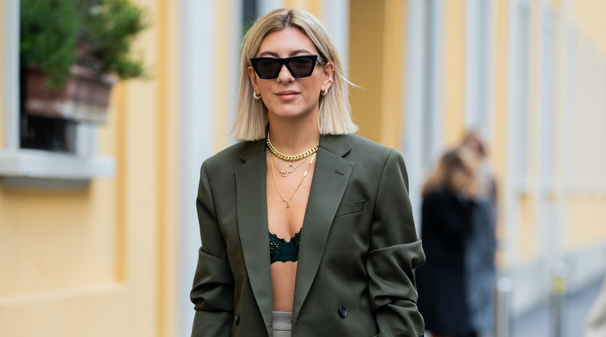 Aylin Koenig is seen weairng white Dior bag, midi skirt, bra, olive blazer outside Boss during Milan...