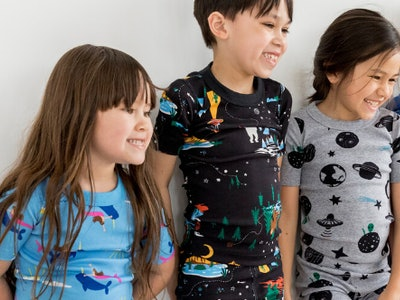 two girls and a boy wearing hanna andersson pajamas