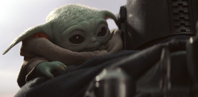 Baby Yoda and Pedro Pascal as Mando in The Mandalorian