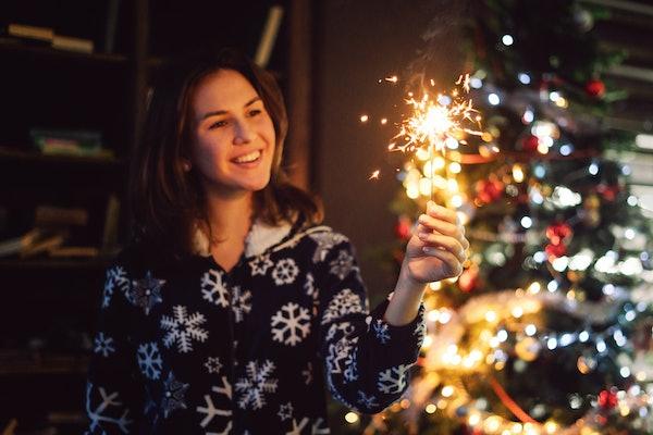 Young woman in Christmas pajamas