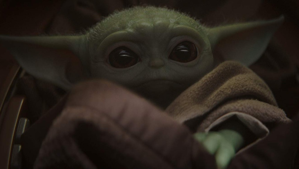 """The Child, aka """"Baby Yoda,"""" is the small, green, wrinkled breakout star of Disney's """"The Mandalorian."""""""