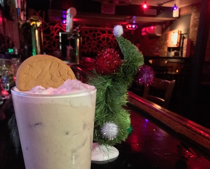 A 'Grinch'-inspired Gingerbread White Russian cocktail sits on the bar of the East Village Tavern wi...