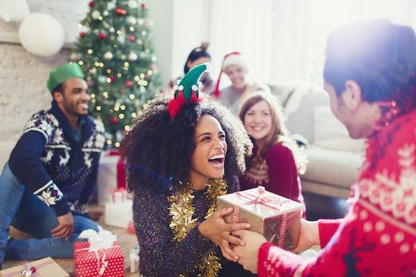Young woman loves Secret Santa present