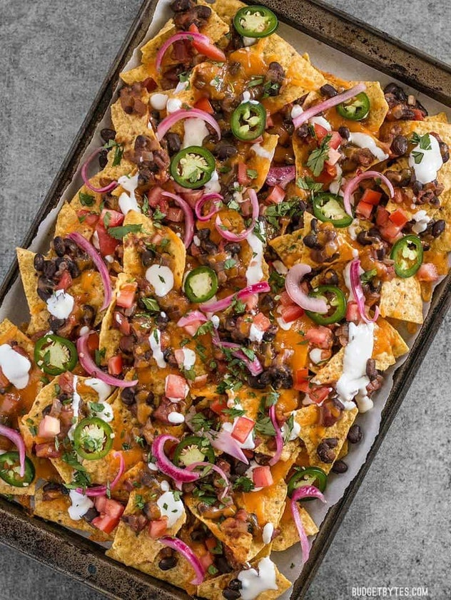 Sheet pan nachos with beef are a fun, communal dinner for the whole family.
