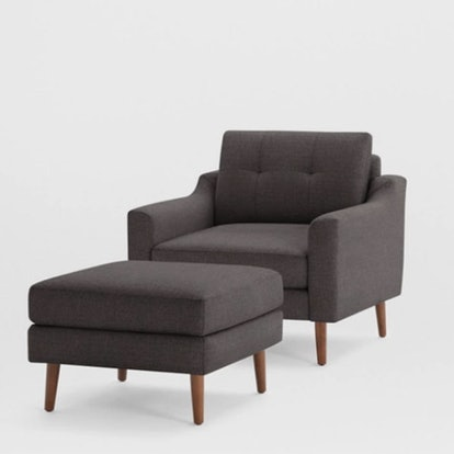 The Nomad Fabric Armchair With Ottoman
