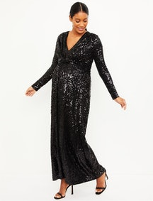 a woman in a sequined black maternity dress from a pea in the pod