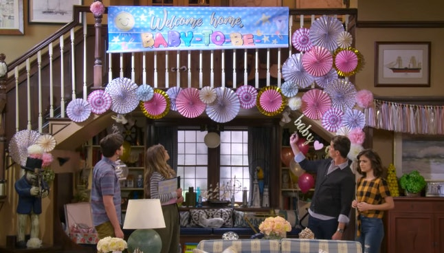 D.J. and family look at the Baby-To-Be-Named-Later banner in Fuller House
